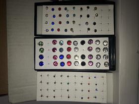 Lotto 255 paia orecchini e piercing vari